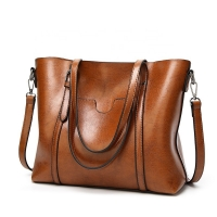 China Classic Styles In Wax PU Leather Handbags Embossed Logo factory