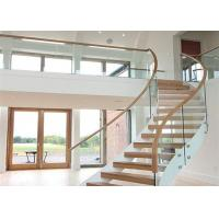 Buy cheap 40mm rubber wood curved stairs with tempered clear glass railing top railing from Wholesalers
