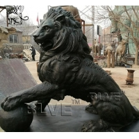 China Large Black Bronze Lion Statue Metal Animal Garden Decoration With Ball factory
