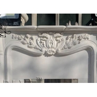 China Solid Hand Carved Marble Fireplace Mantel Freestanding Fireproof Stone For Home factory