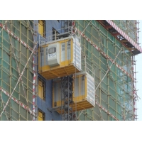 China Double Cage Construction Site 1.5m Passenger And Material Hoist factory
