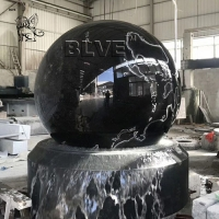 China Marble Floating Ball Feng Shui Water Fountain Garden Black Natural Stone factory