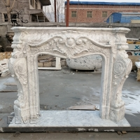 China Carrara Marble Fireplace Modern Hand Carved Freestanding Fireplaces European Style factory
