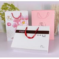 White matt gift paper bags with black hot foil stamping